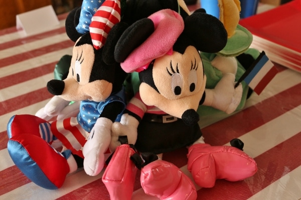 a variety of plush Minnie Mouse toys representing different countries