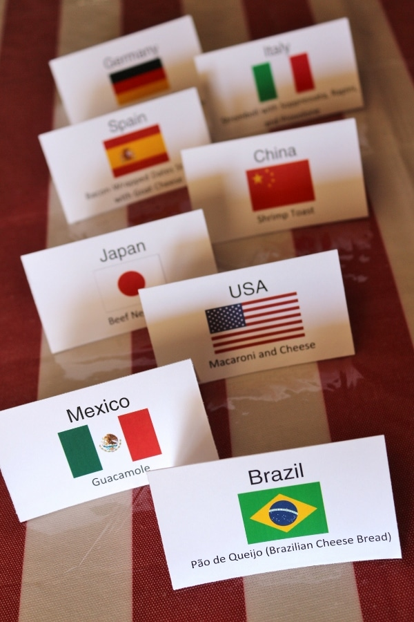 a bunch of folded cards with flags and country names printed on them