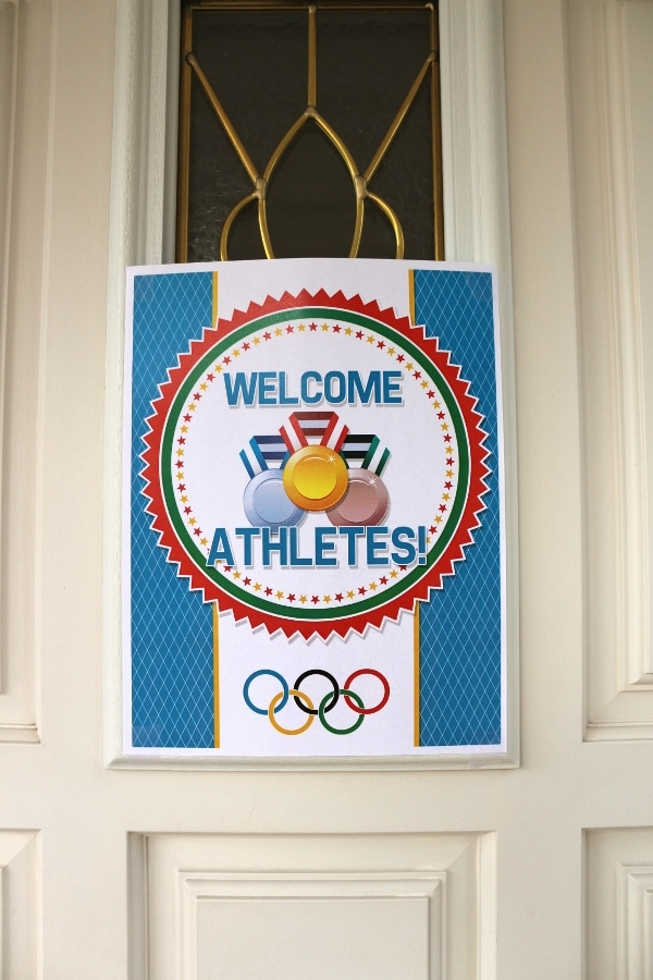 a Welcome Athletes Olympic sign on a door