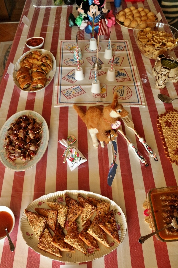 A table topped with platters of food for the Olympic party