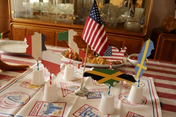 A dining table decorated with various flags