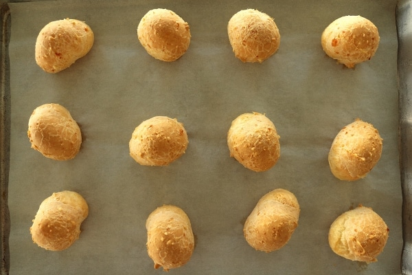 overhead view of a baking sheet of Brazilian cheese bread