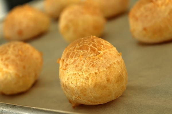 A close up of a tray of Brazilian cheese bread