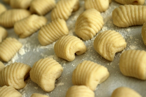 closeup of ricotta cavatelli on a flour-dusted baking sheet