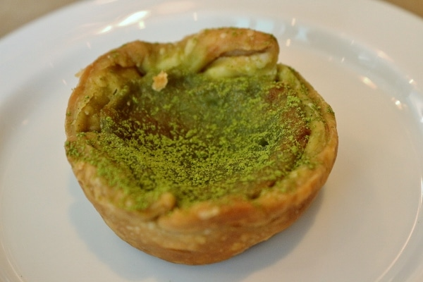 a small tart dusted with green matcha tea