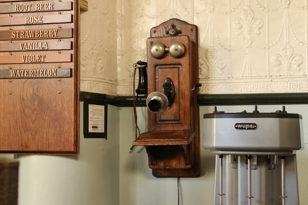 an old telephone on a wall