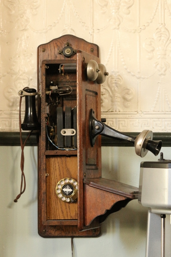 the inside of an old telephone on a wall