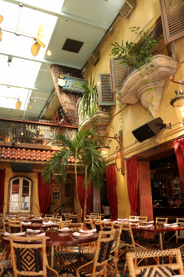 interior of a Cuban restaurant that looks like it\'s outside