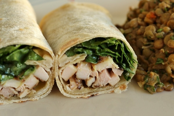 a chicken shawarma wrap cut in half and served on a plate
