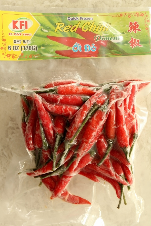 a bag of frozen red Asian chile peppers
