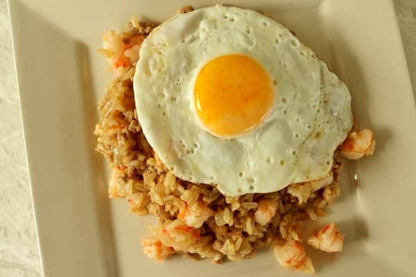 overhead view of nasi goreng (Indonesian fried rice) with a fried egg on top