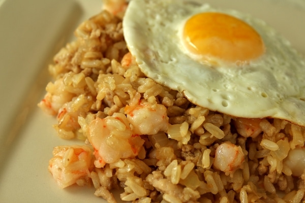 a plate of nasi goreng fried rice topped with a fried egg
