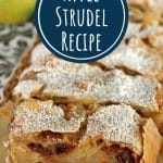 a platter of sliced apple strudel topped with powdered sugar