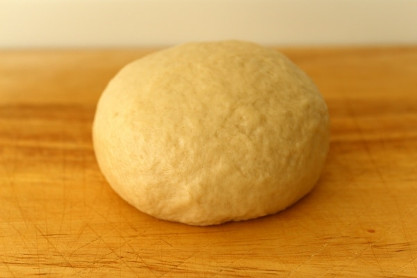 a ball of dough on a wooden board