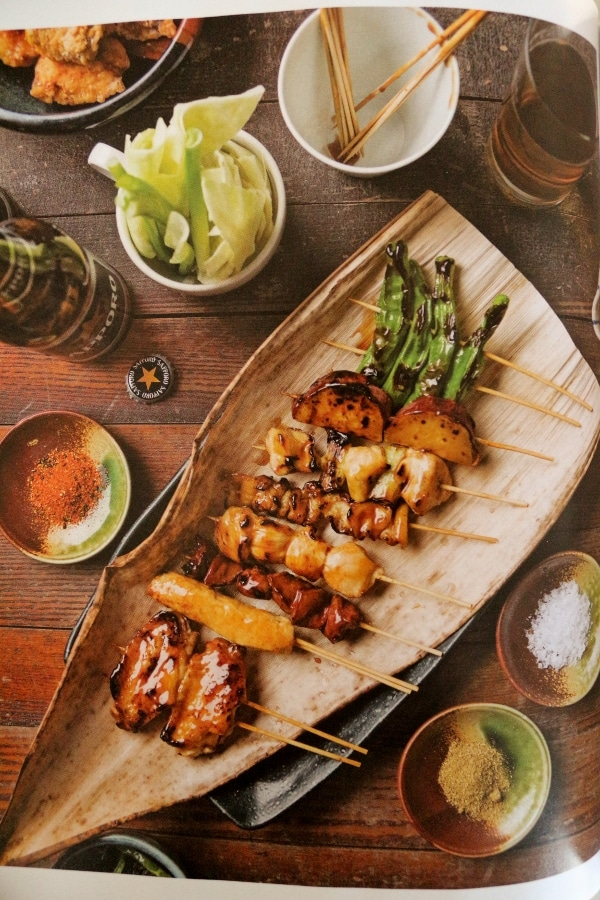 a photo of foods on skewers from Mastering the Art of Japanese Home Cooking cookbook