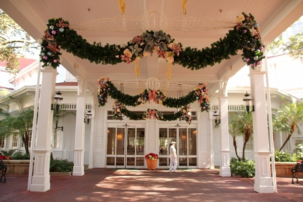 entrance to Disney\'s Grand Floridian Resort with floral garlands hanging above