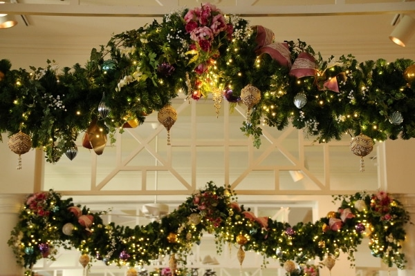 a closeup of Christmas garlands hanging from above