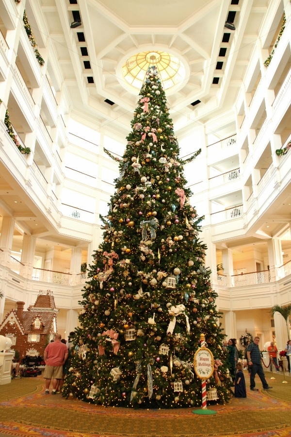 a large Christmas tree inside a hotel lobby