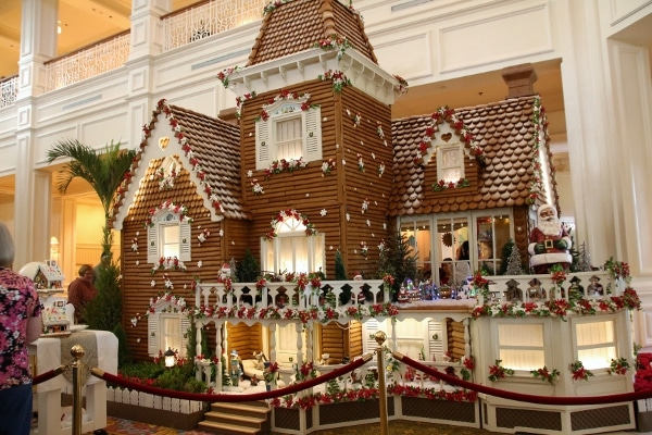 a large gingerbread house inside the Grand Floridian lobby