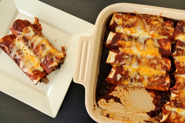 overhead view of enchiladas in a casserole dish and served on a plate