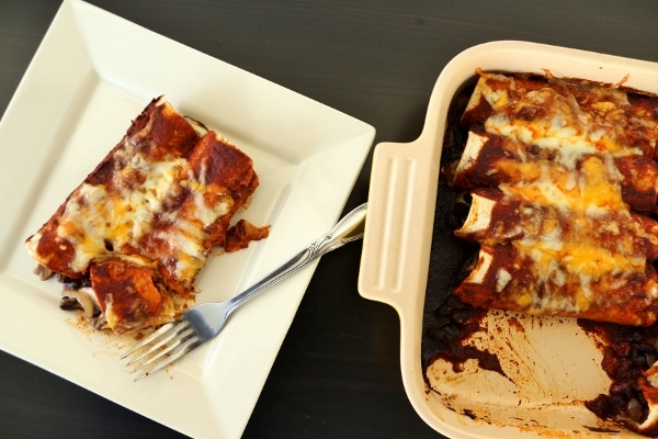 overhead view of a serving of enchiladas with red sauce and melted cheese