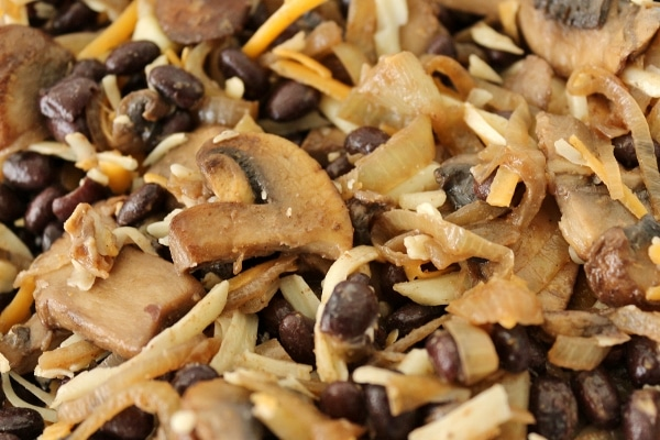 closeup of mushroom, black bean, onion, and cheese filling in a bowl