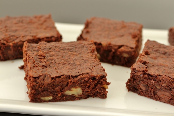 a side view of a platter of brownies made with walnuts and chocolate chips