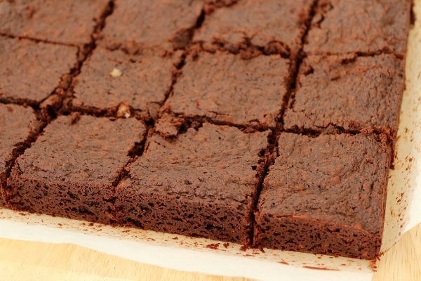 side view of brownies on a cutting board cut into squares