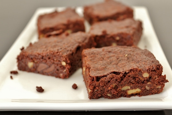 side view of a plate of brownies with walnuts and chocolate chips
