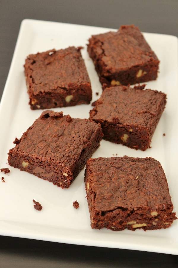 a wide view of a plate of brownies with walnuts and chocolate chips