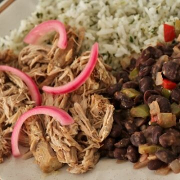 Mojo pork with black beans, cilantro rice, and pickled red onions