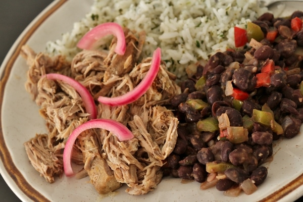 slow-cooked mojo pork with black beans, cilantro rice, and pickled red onions