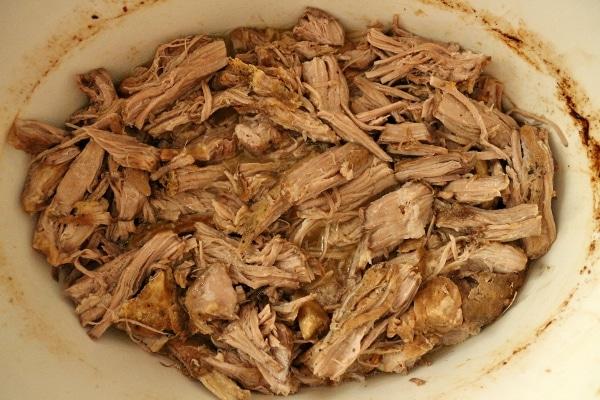 pulled chunks of fork-tender pork in a slow-cooker