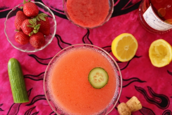 overhead view of a pink cocktail surrounded by various ingredients