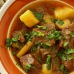 A bowl of Burmese beef curry with potatoes