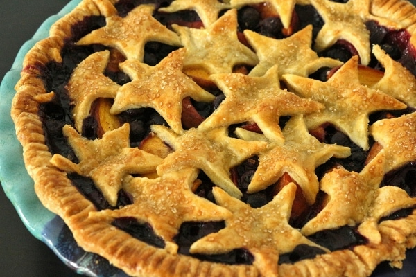 a fruit pie with star cutouts making up the top crust