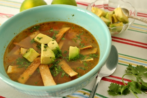 side view of a bowl of Yucatan-style lime soup with chicken