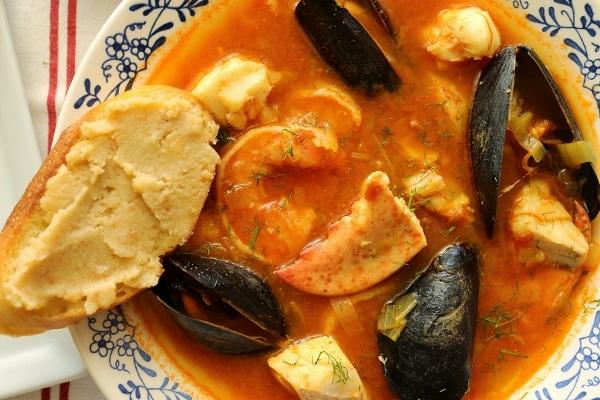 a closeup of a bowl of bouillabaise seafood stew