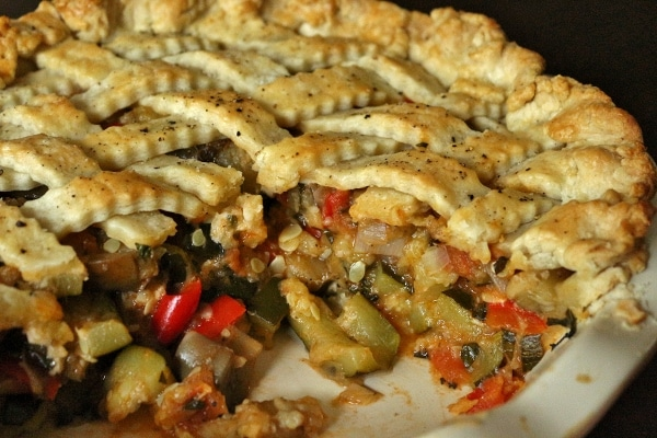 cross section of a sliced ratatouille pie full of summer vegetables