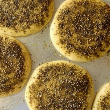 round loaves of za'atar bread on a baking sheet