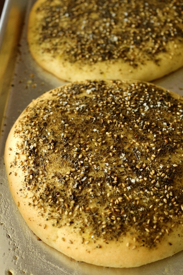 2 round loaves of bread topped with za\'atar spice