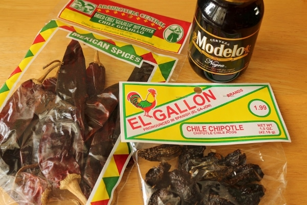 Packages of dried chiles, and a bottle of Modelo Negro Mexican beer