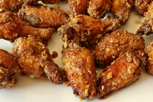 closeup of fried chicken wings on a white plate