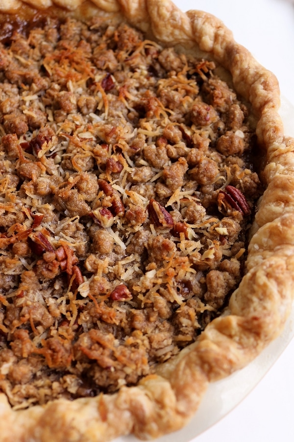 an overhead view of a hummingbird pie with pecan coconut crumble topping