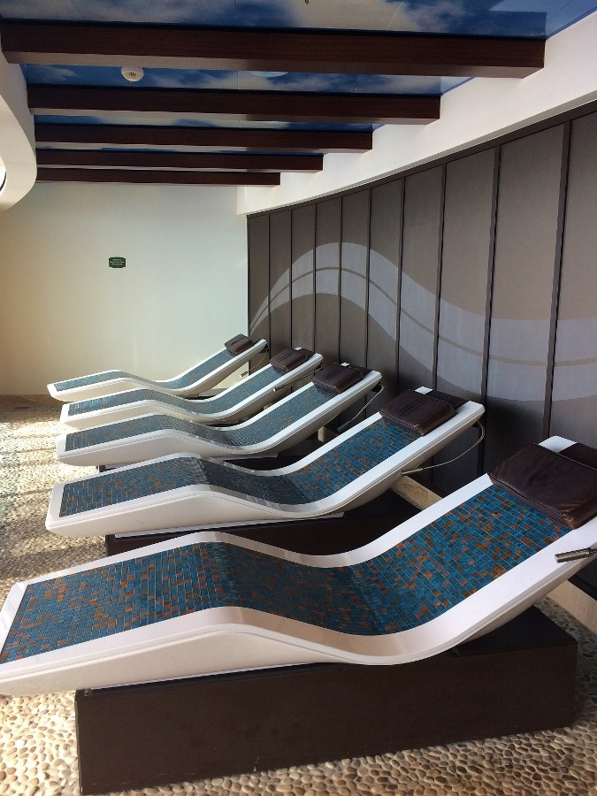 a row of tiled lounge chairs