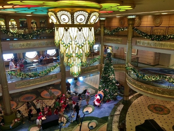 overhead view of Santa greeting guests in the Disney Fantasy lobby atrium