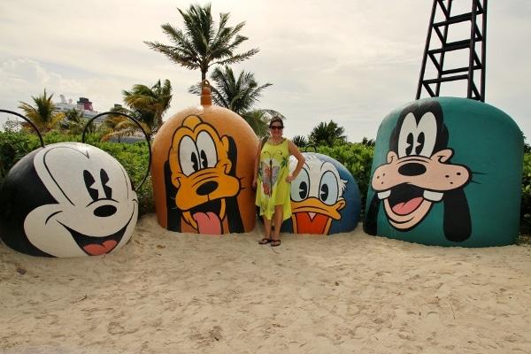 a woman posing at Mount Rustmore on Disney\'s Castaway Cay
