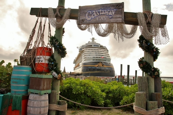 view of the Disney Fantasy cruise ship through Castaway Cay sign