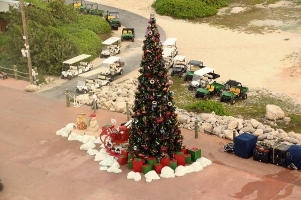 wide view of the Christmas tree on Castaway Cay with golf carts parked nearby