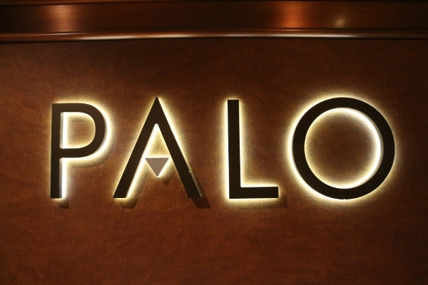 A large sign that says Palo